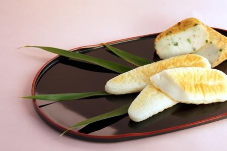 12851017 - sasakamaboko, boiled fish paste that shaped  banboo leaf