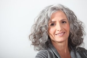 17220514 - grey-haired woman on white background