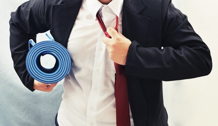 42554307 - business man holding yoga mat , exercise concept