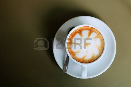 30942148-cappuccino-or-latte-hot-coffee-with-leaf-shape-,-close-up.