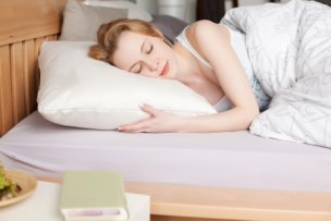 21279706 - portrait of sleeping female with book on the table