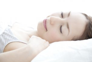 51371004 - woman sleeping in a bed
