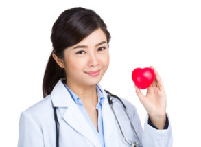 31584745 - medical female doctor with heart shape ball