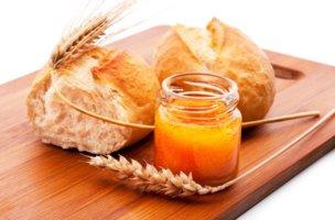 12353740 - freshly baked bread rolls, wheat ears and honey
