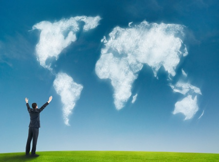 8852805 - businessman with world map shaped clouds