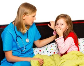 33282125 - doctor examining her little patient with severe coughing.