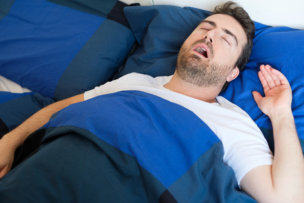 91124214 - man in bed suffering for sleep apnea syndrome