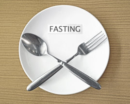 32697671 - fasting paper and fork with spoon symbol on white plate